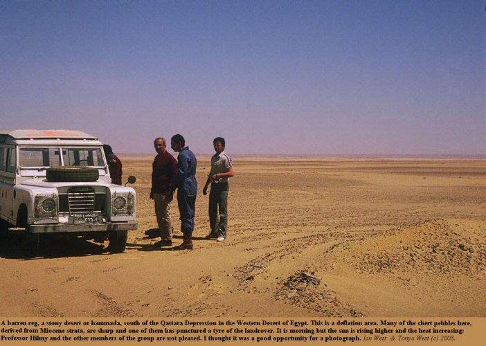 A reg or hammada, stony desert, south of the Qattara Depression, Western Desert, Egypt, with party stranded by a puncture