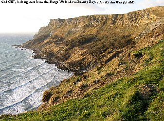 Gad Cliff, Dorset, looking westward from the Range Walk above Brandy Bay, Jan 05 with low sun