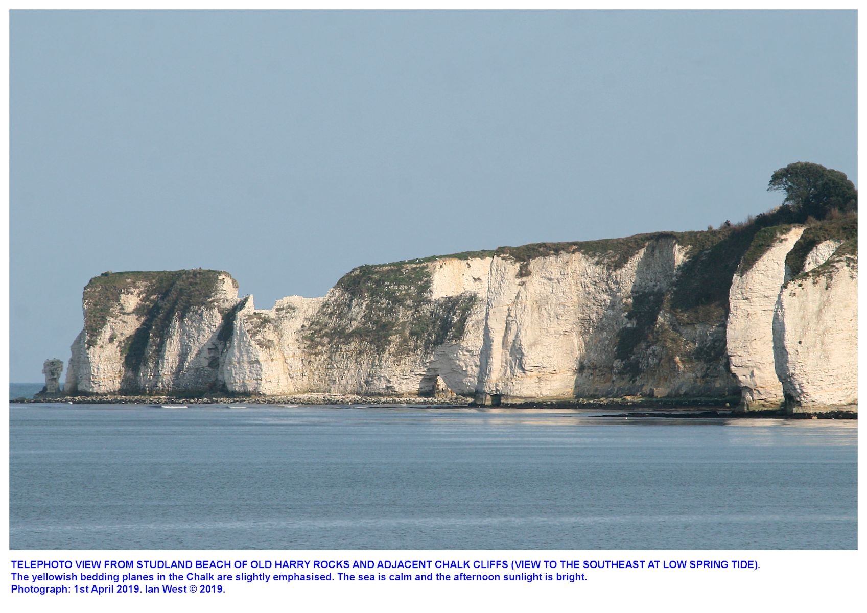 Old Harry Rocks and The Foreland, Dorset, viewed, in the distance and with enlargement, from Studland Beach, 1st April 2019