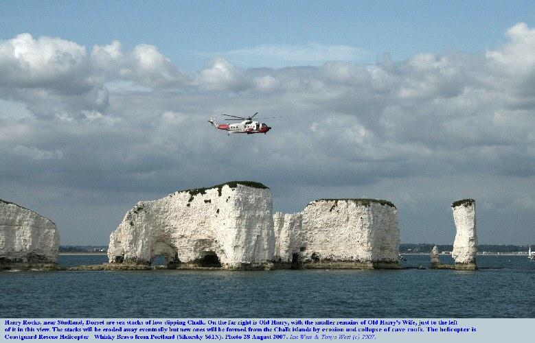 Harry Rocks, Dorset, seen from the sea, with the Coastguard Rescue Helicopter hovering about the sea stacks, August 2007