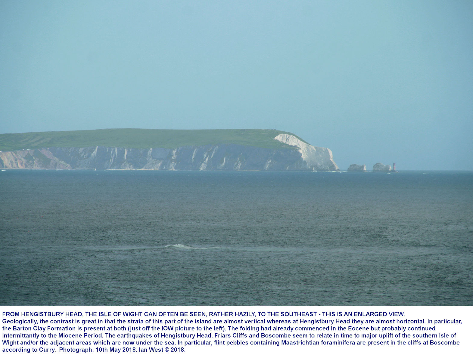 A distant, rather hazy view of the Isle of Wight from Hengistbury Head, enlarged by telephoto lens, 2018