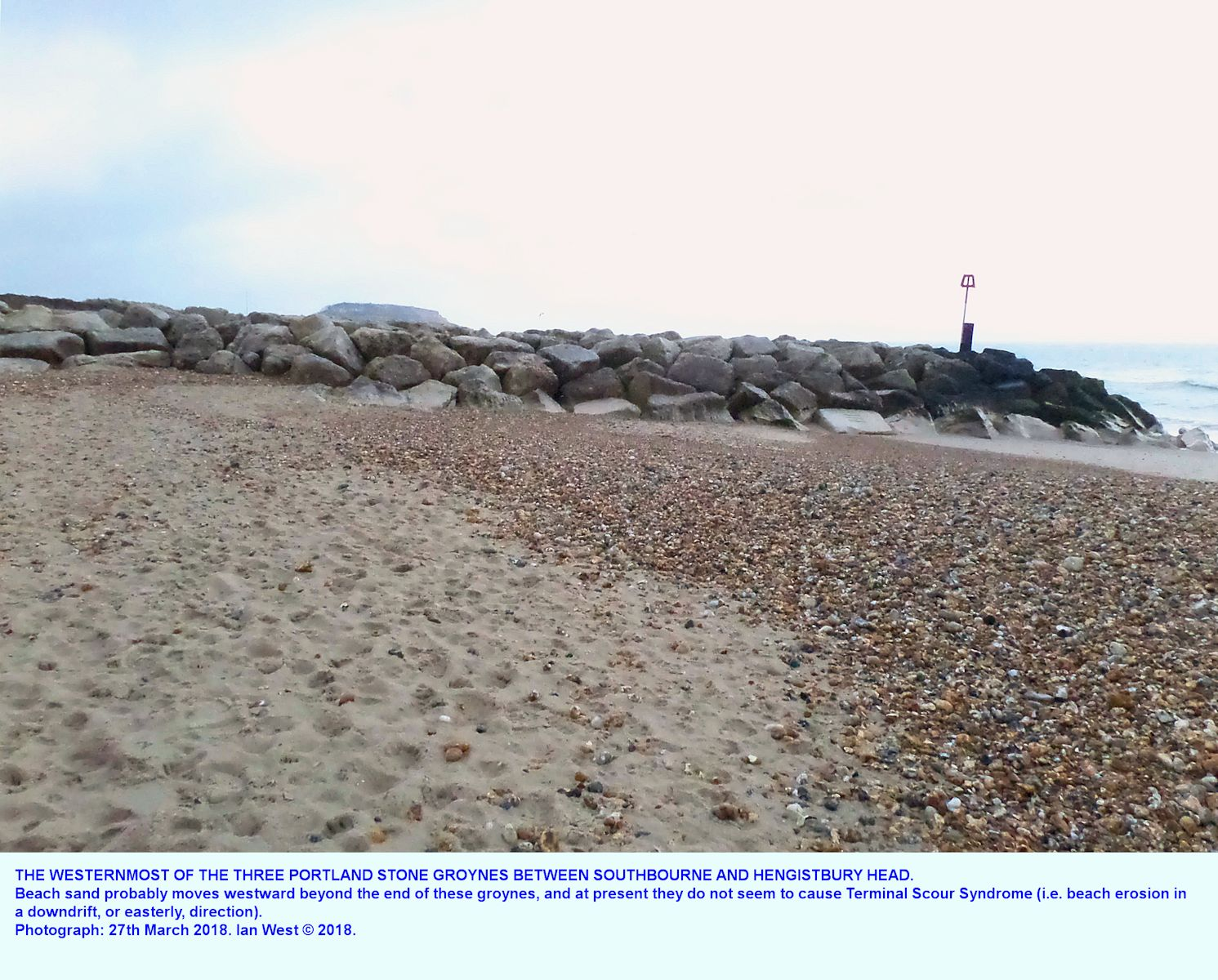 A general view from the beach of the westernmost of the three groynes of Portland Stone blocks between Southbourne and Hengistbury Head, seen from the mid beach, looking eastward
