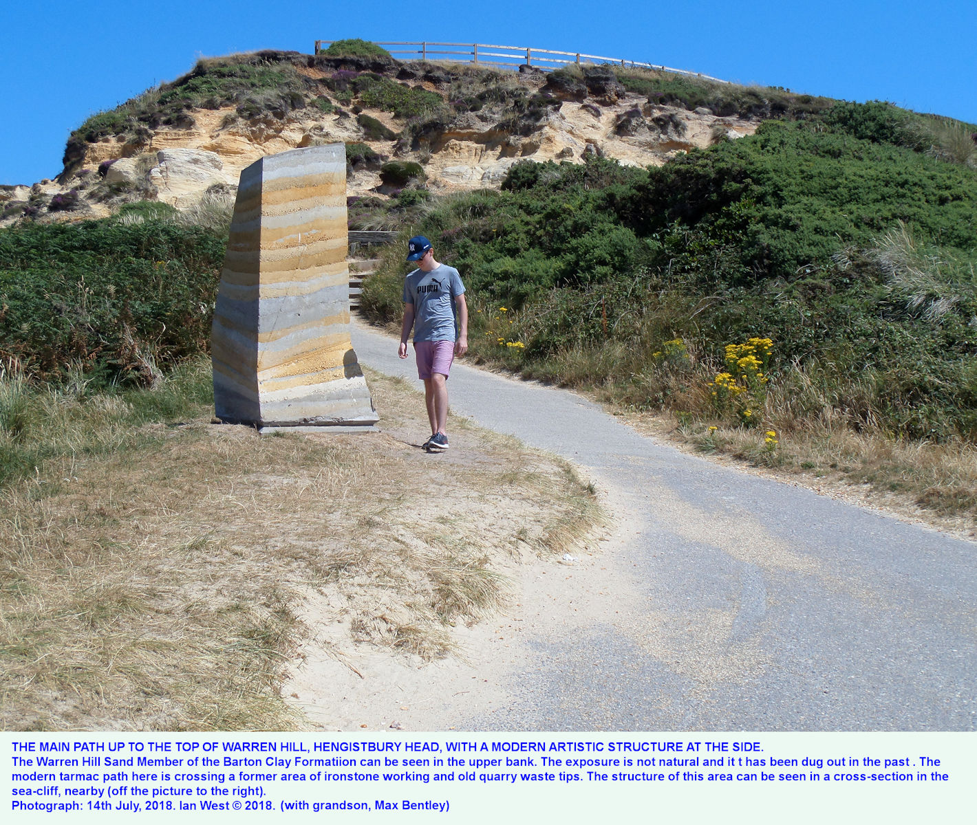 The main path to the highest point of Warren Hill, Hengistbury Head, with an artwork by the side of the path, 14th July 2018