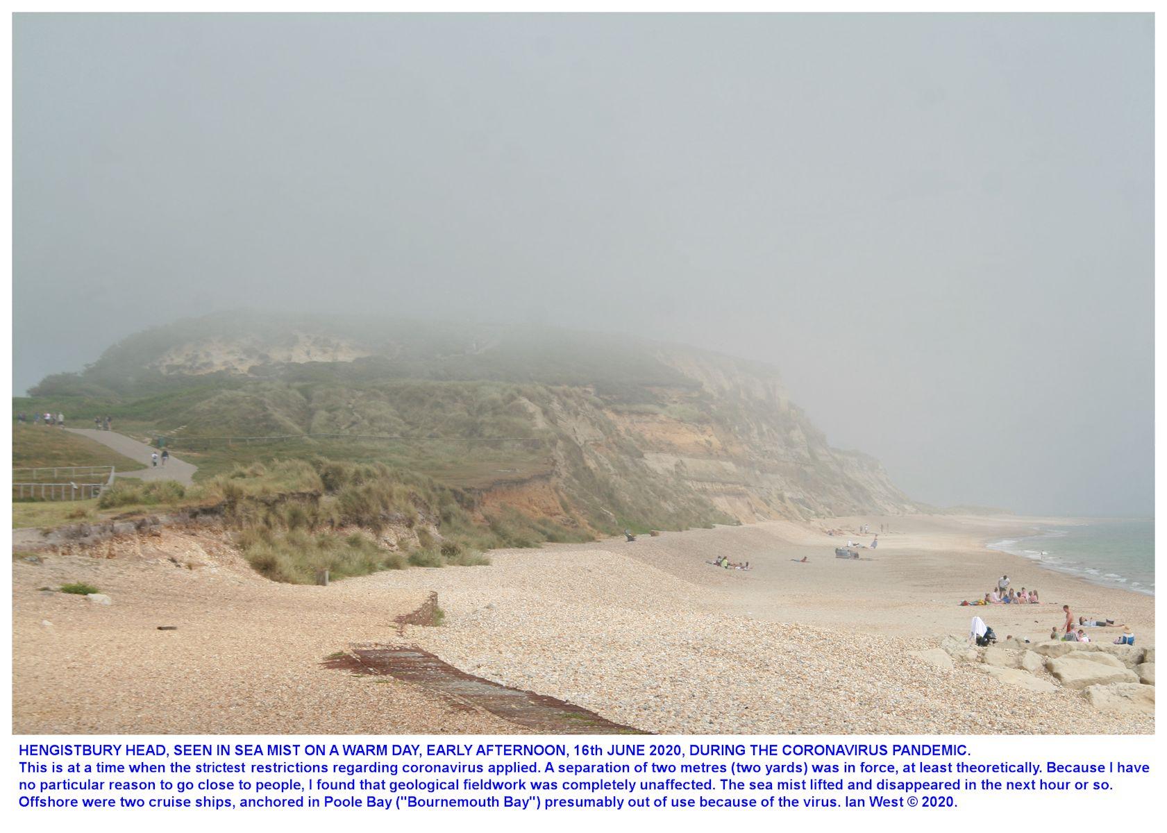 Hengistbury Head in sea-mist on a hot summer day, June 2020, during the coronavirus epidemic