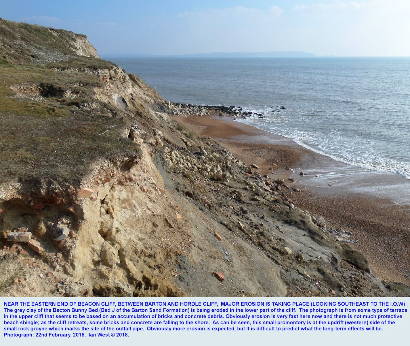 Collapsing cliff, with brick and concrete debris, at a small promontory of rock armour at the Sewer outfall promontory, at the eastern end of Beacon Cliff, between Barton-on-Sea and Hordle Cliff, Hampshire, southern England, 22nd February 2018