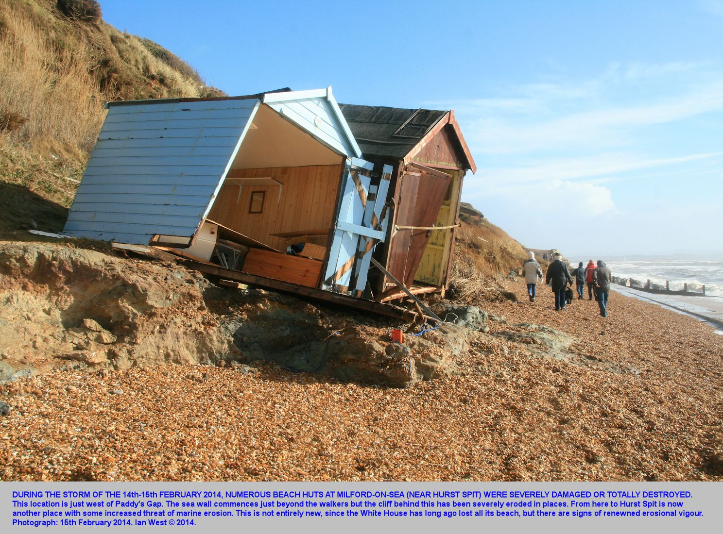 Beach huts at Paddy's Gap, west, Milford-on-Sea, near Hurst Spit, Hampshire, damaged by storm action on the 14th-15th February 2014