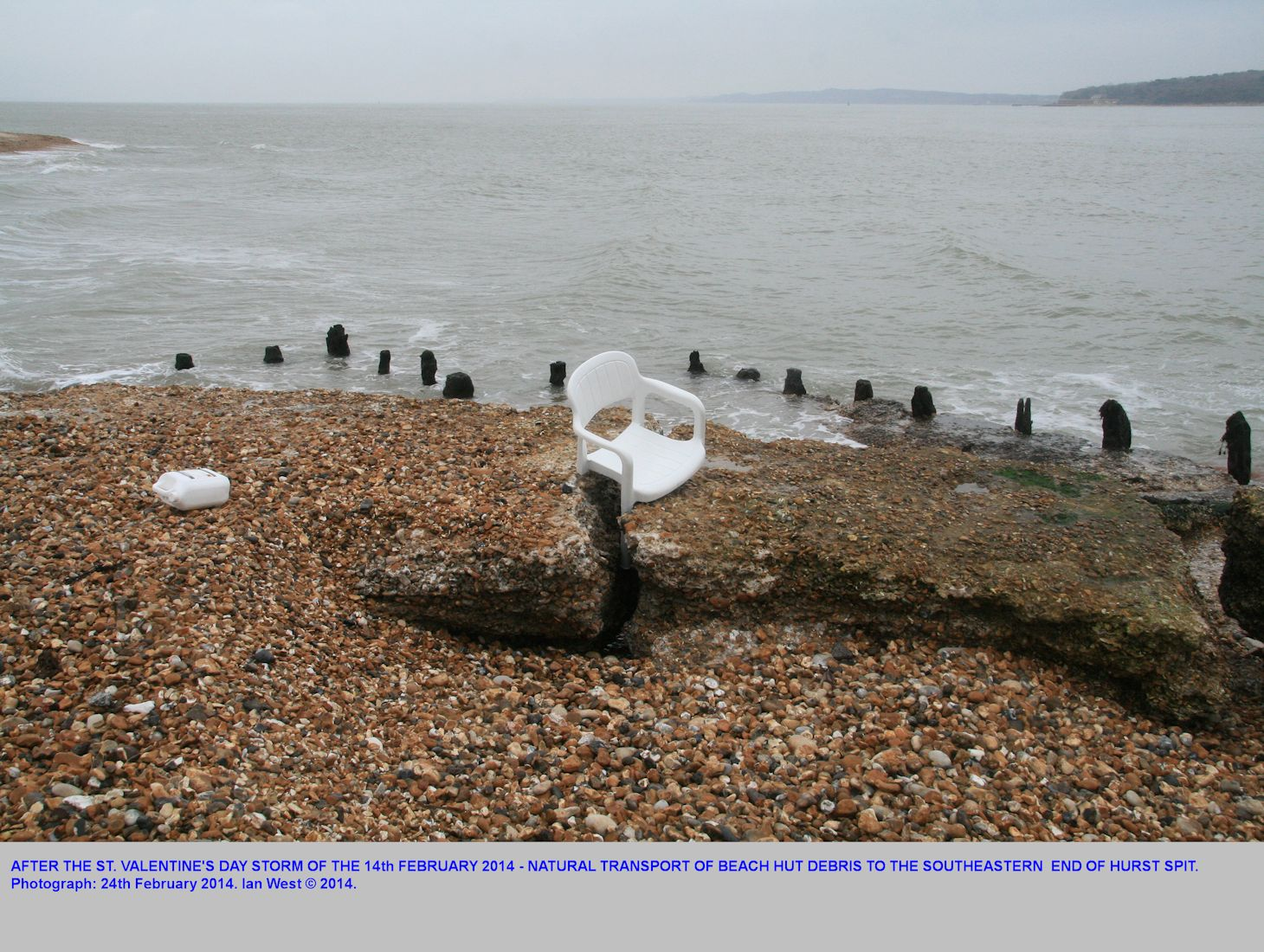 Beach hut debris, including plastic chairs, have been transported by the St. Valentine's Day Storm along Hurst Spit, Hampshire, even to the southeastern end