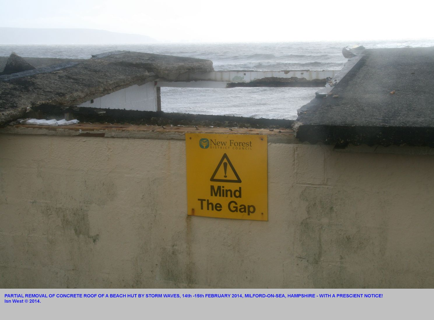 A prescient notice on a concrete beach hut damaged by storm waves, Milford-on-Sea, near Hurst Spit, Hampshire, 15th February 2014