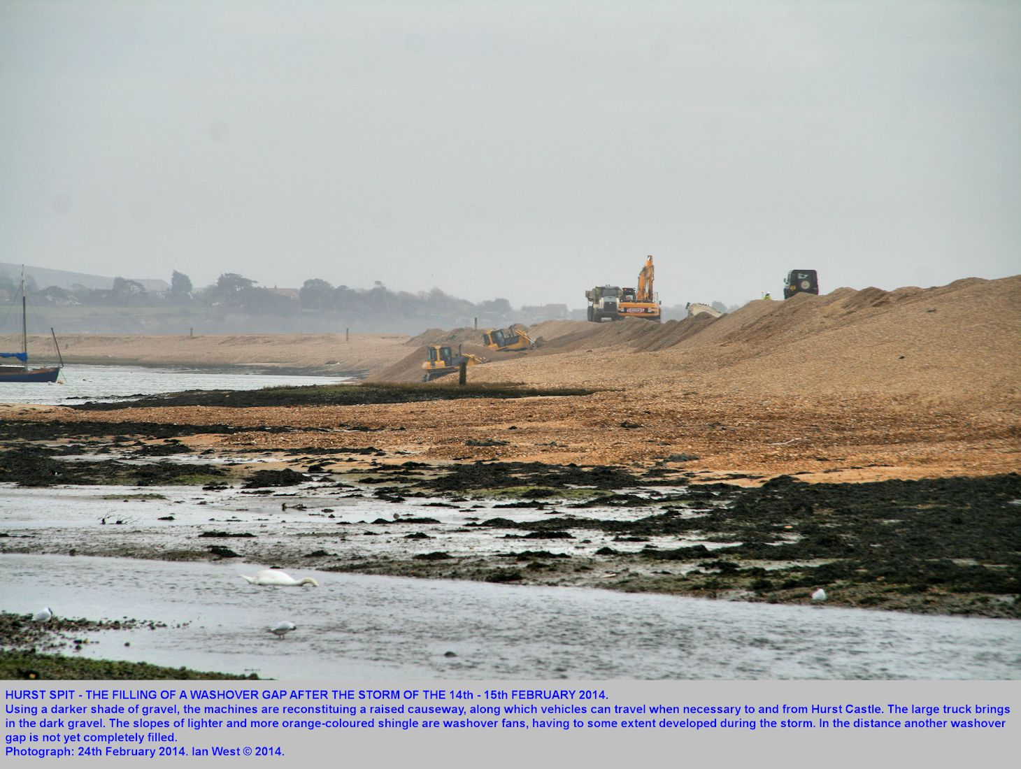 Machines start to repair washover gaps from storms at Hurst Spit, Hampshire, 24th February 2014