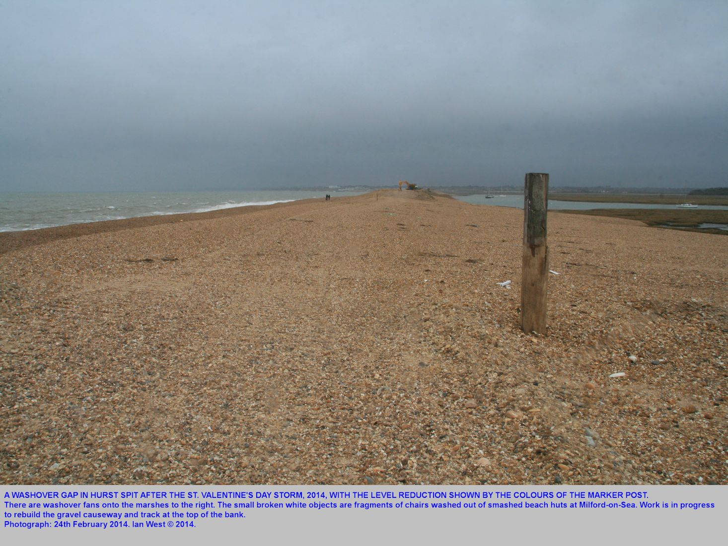 A marker post shows the extent of beach-lowering at a washover gap on  Hurst Spit, Hampshire, after the St. Valentine's Day Storm, photograph 24th February 2014