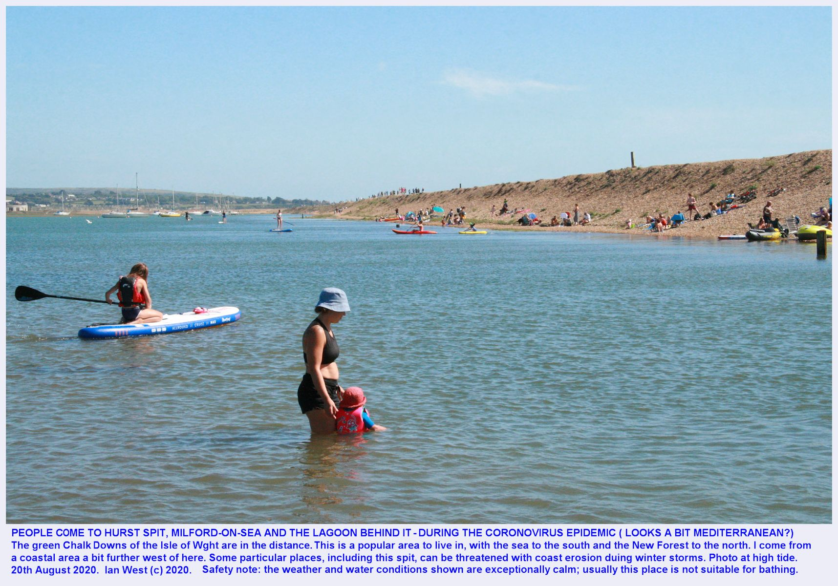 At the landward part of Hurst Spit, behind the bank and near the small footbridge, with some people paddling in the estuary water at high tide, during the Coronavirus Epidemic, August 2020