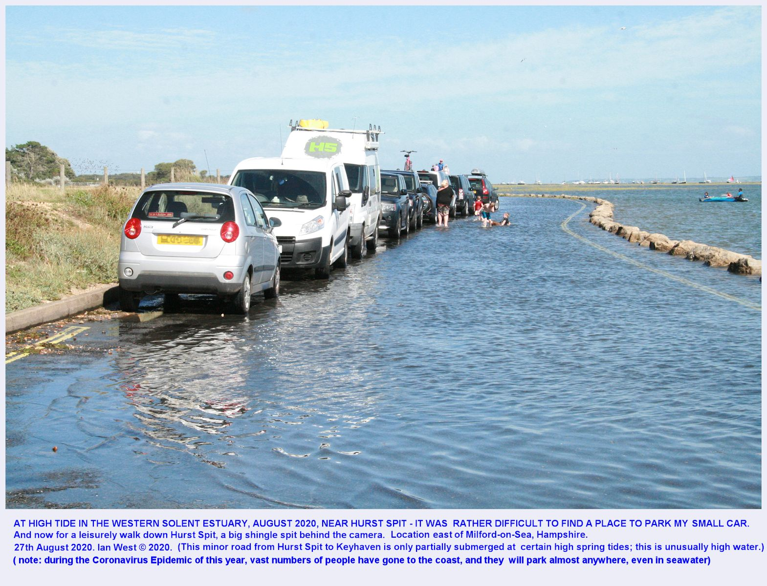 The minor road from Hurst Spit to Keyhaven is seen flooded at a very high tide, with vehicles parking in the shallow sea water, August 2020, Ian West