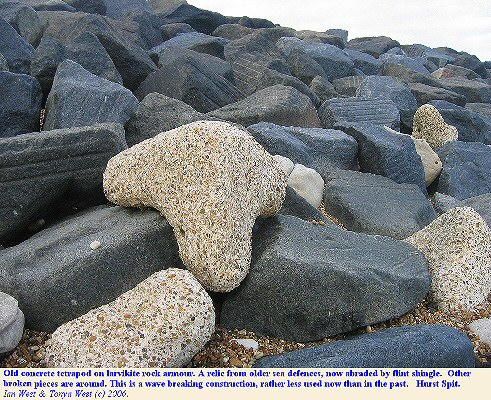 Concrete tetrapod, relic of older sea-defences on the seaward side of rock armour at Hurst Castle Spit, Hampshire