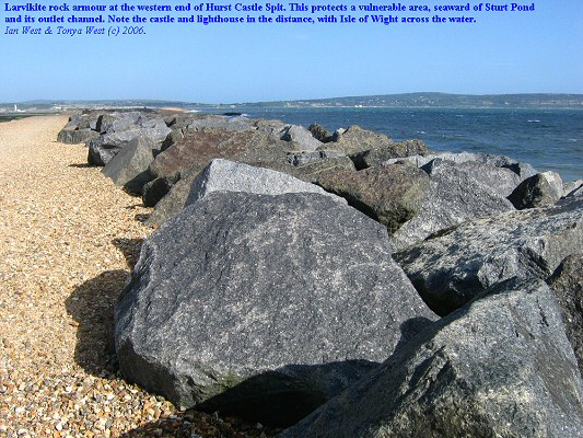 Larvikite rock armour at the western end of Hurst Castle Spit, Hampshire