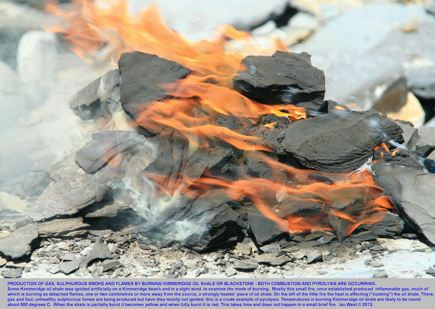 Burning blocks of Kimmeridge oil shale or blackstone, a potential source of shale gas, seen in a small artificially started fire at Kimmeridge, Dorset, 2013