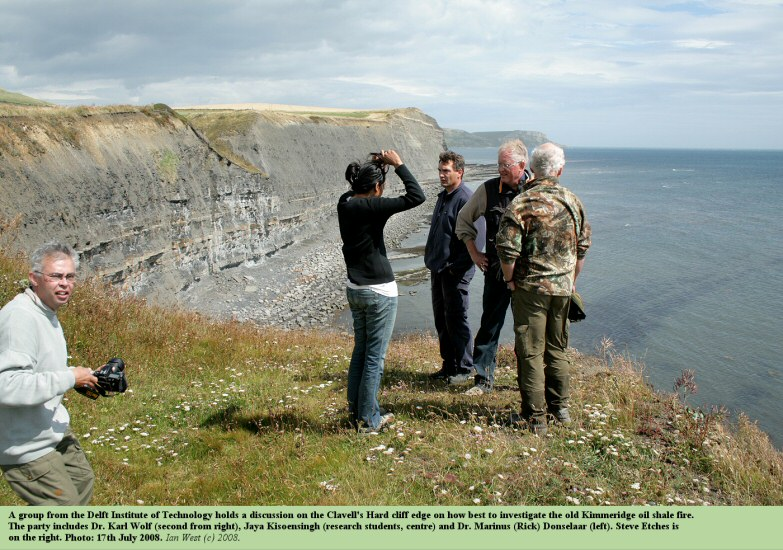 A group from Delft university, researching on oil shale fires, hold a discussion on the cliff edge above Clavell's Hard, Kimmeridge, Dorset, 2008