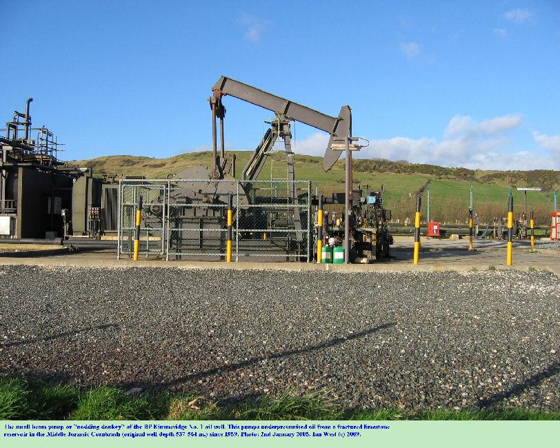The small nodding donkey or beam pump of the Kimmeridge No. 1 oil well, Kimmeridge Bay, Dorset, 2005