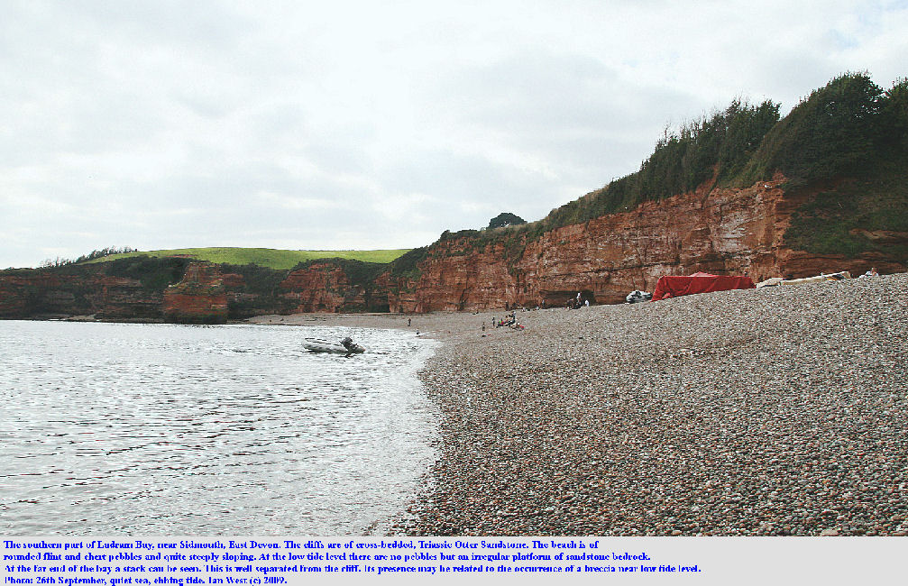 Southern part of Ladram Bay, East Devon, with a beach of rounded flint and chert pebbles and cliffs of red, Triassic, Otter Sandstone