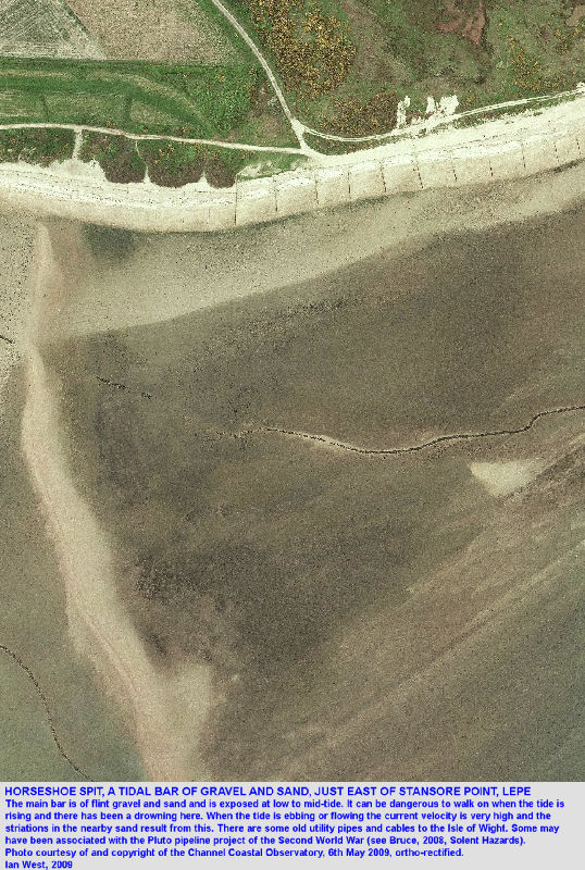 A closer aerial photograph of Horseshoe Spit, a transverse tidal bar or spit of shingle at Stansore Point, West Solent estuary, Lepe, Solent, Hampshire, seen at low tide, and with pipelines nearby