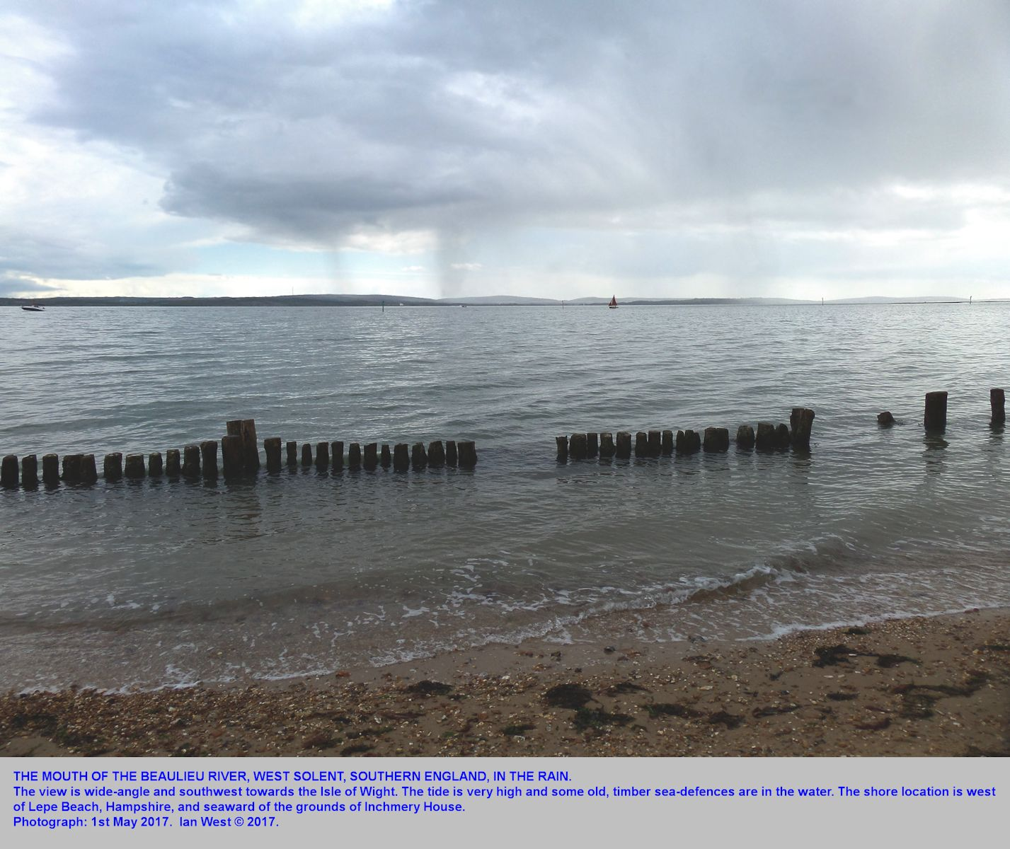 View of the mouth of the Beaulieu River and the West Solent, seen from the west of Lepe Beach, Hampshire, during rain showers, 1st May 2017