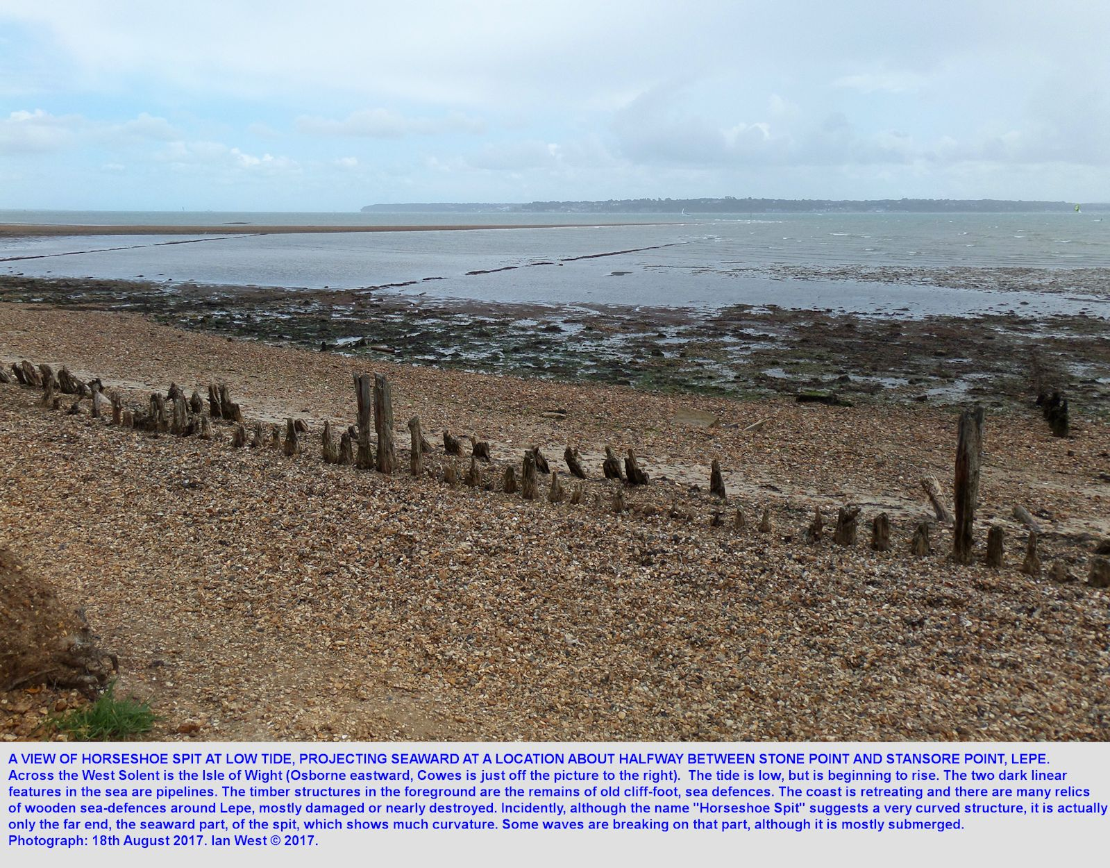 Horseshoe Spit, in the West Solent estuary near Lepe Beach, Hampshire, a transverse spit of shingle seen at a low, but rising tide, 18th August 2017