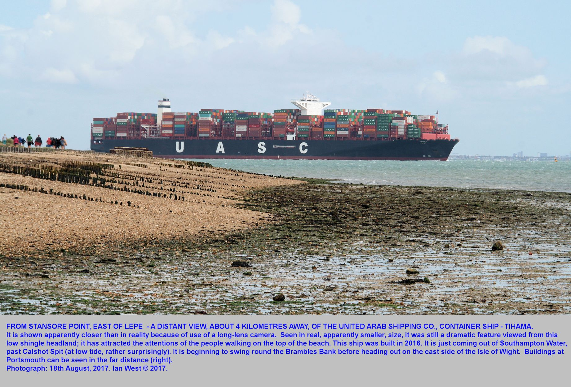 An unusually large ship, the Tihama of the United Arab Shipping Company, leaving Southampton Water, near Calshot Spit, but seen from Stansore Point, near Lepe,  Hampshire, 18th August 2017