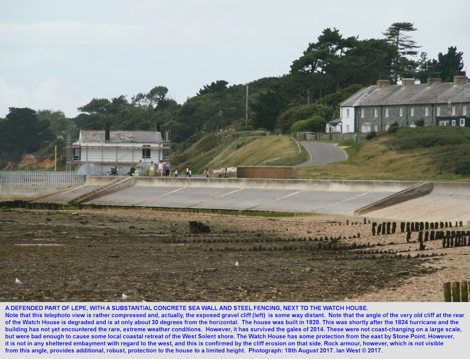 The east side of the Watch House, Lepe, Hampshire, with part of the coastguard cottages, a hill behind it, 18th August 2017