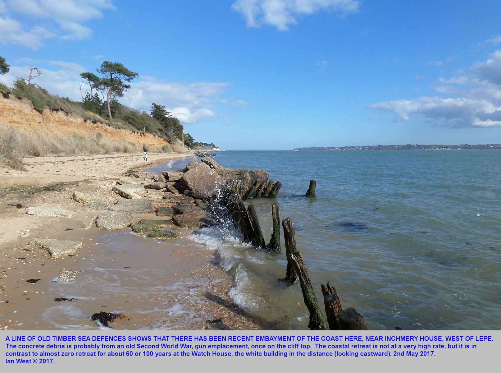 Some cliff erosion and retreat of the beach at some old gun emplacement debris, near Inchmery House, west of Lepe Beach, Hampshire, as seen on 2nd May 2017
