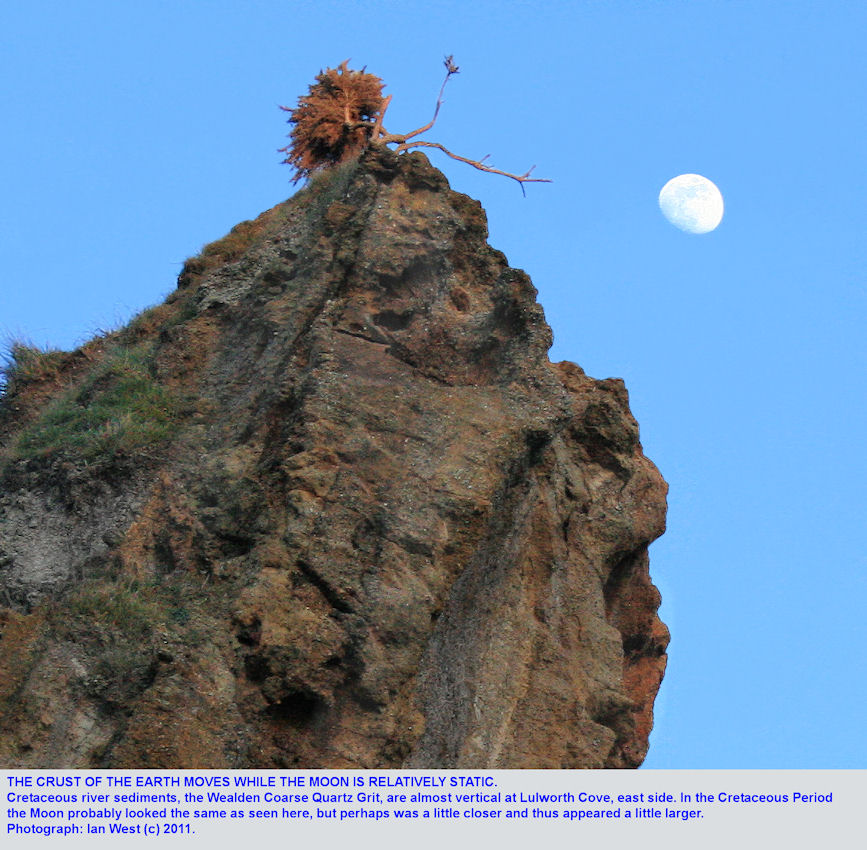 The top of the ridge of the Coarse Quartz Grit on the east side of Lulworth Cove, Dorset, with the Moon above