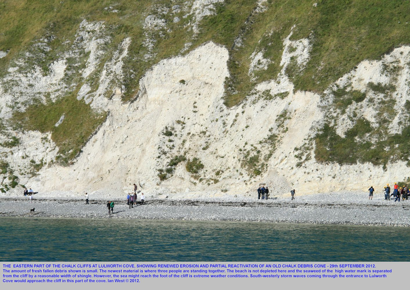 A distant view of renewed chalk debris falls at Lulworth Cove, Dorset, seen from the shore near the Eastern Horn, 29th September 2012