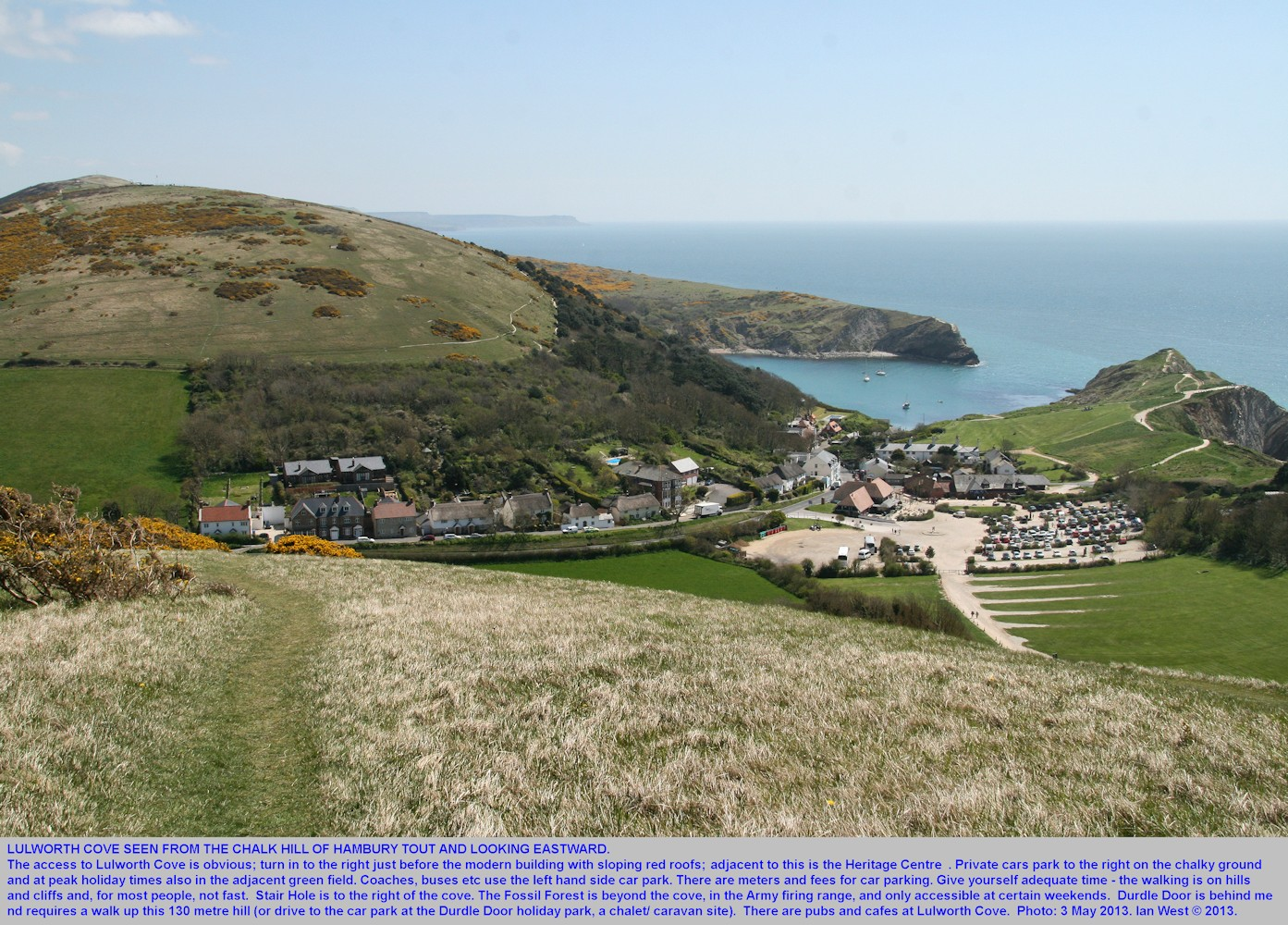An introductory overview of Lulworth Cove, Dorset, seen from Hambury Tout, a hill on the west side, 3rd May 2013