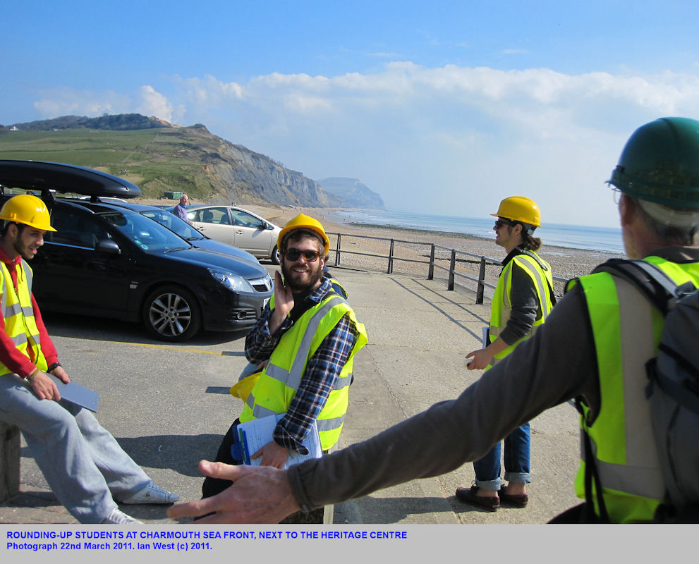 Rounding-up civil engineering students at Charmouth, Dorset, March 2011