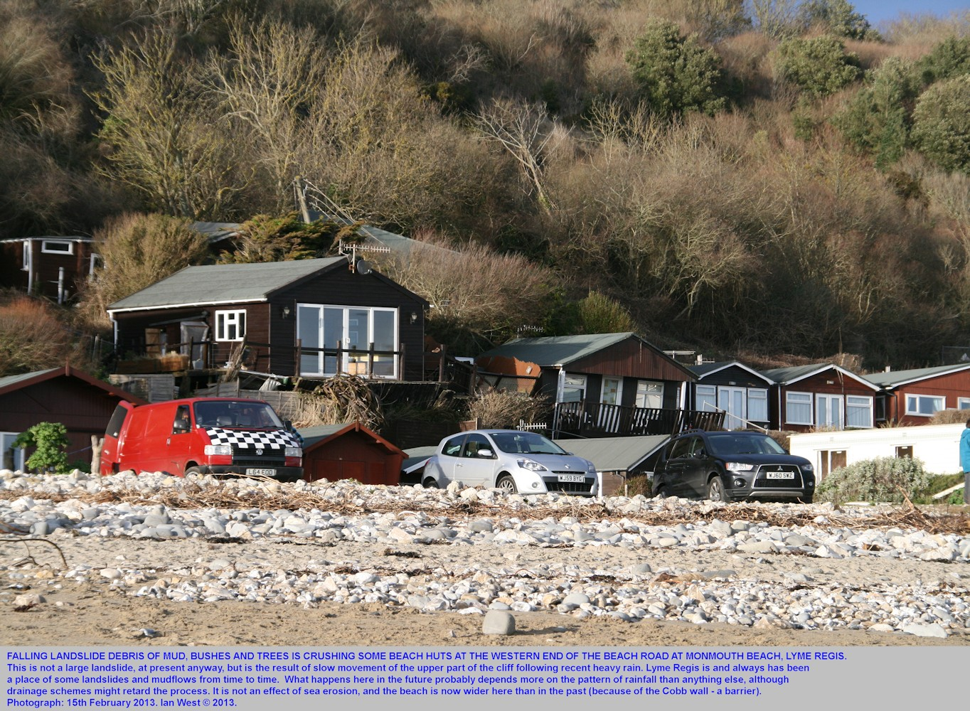Debris descending on beach huts at the western end of the beach road, Monmouth Beach, Lyme Regis, Dorset, 15th February 2013