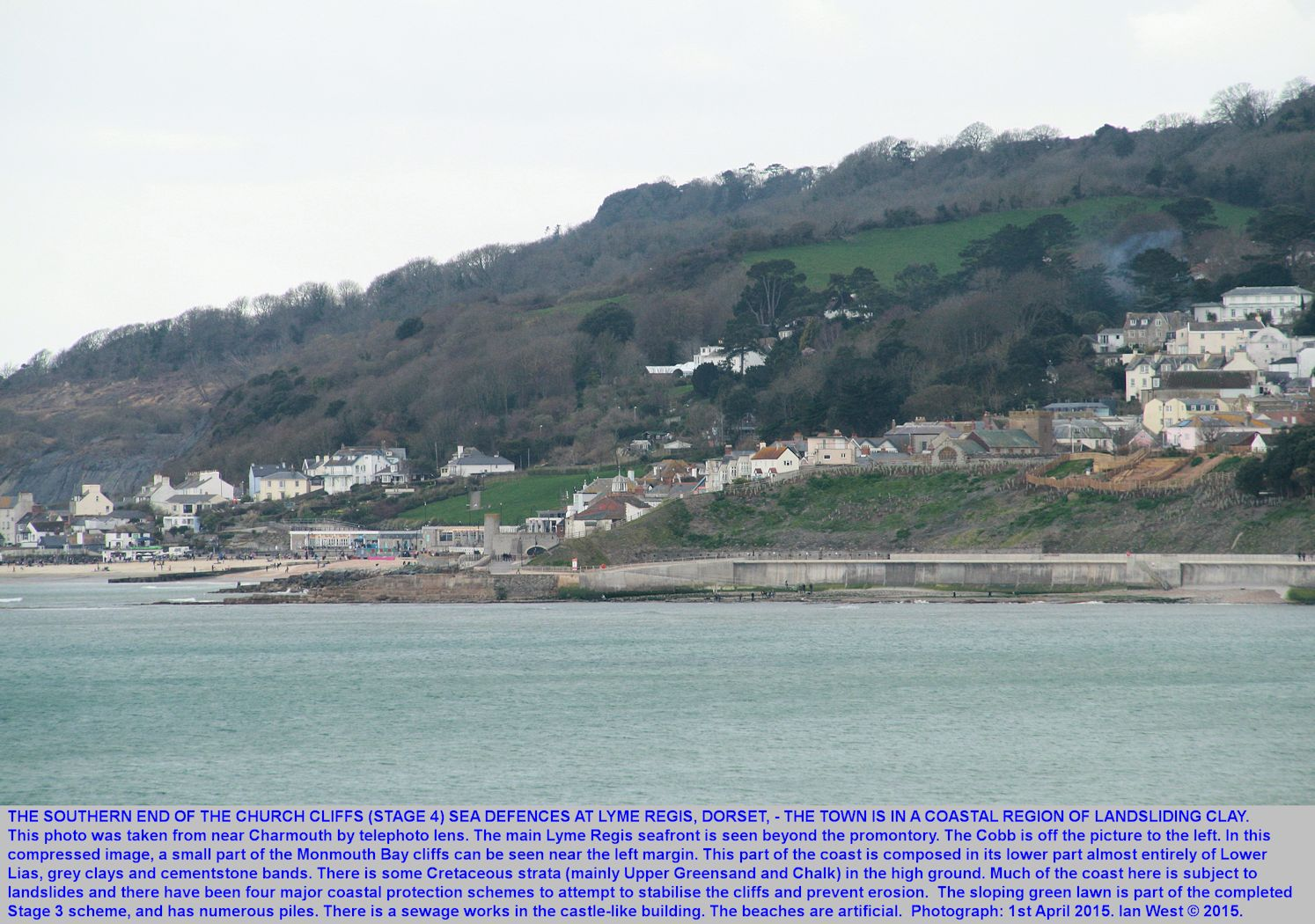 Telephoto view from near Charmouth of the southern part of the (2014-2015) sea wall and promenade at Lyme Regis, Dorset, April 2015