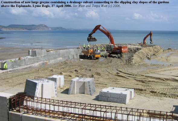 Construction of a new, large groyne on the beach at Lyme Regis, Dorset, containing a drainage culvert for removing water from the slipping clay slopes above the Marine Parade