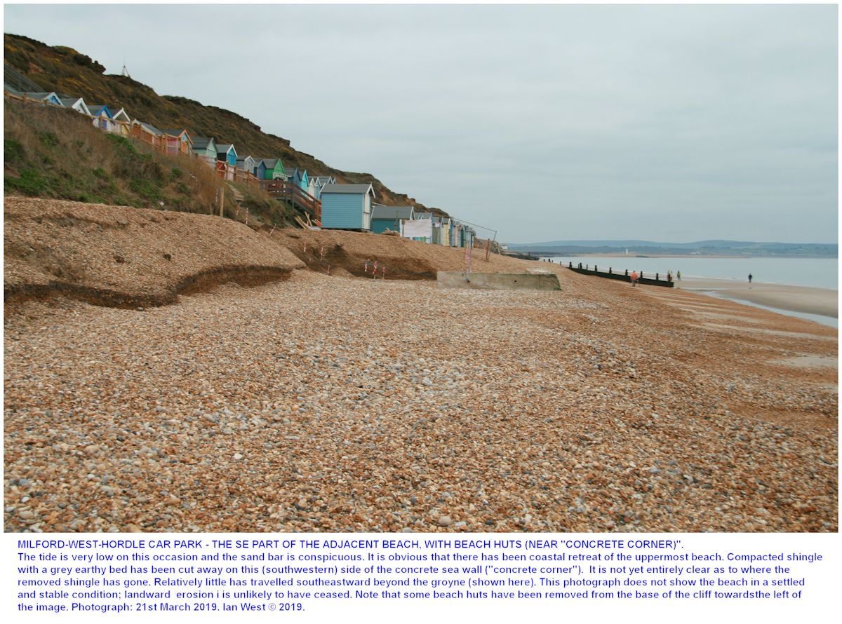 A view at low tide of the erosion area, adjacent to beach huts, at Milford-West-Car-Park, 21st March 2019