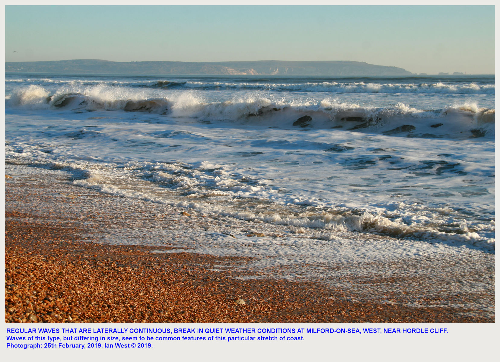 Regular, long waves breaking at Milford-West-Hordle-beach, in quiet weather conditions, 25th March 2019