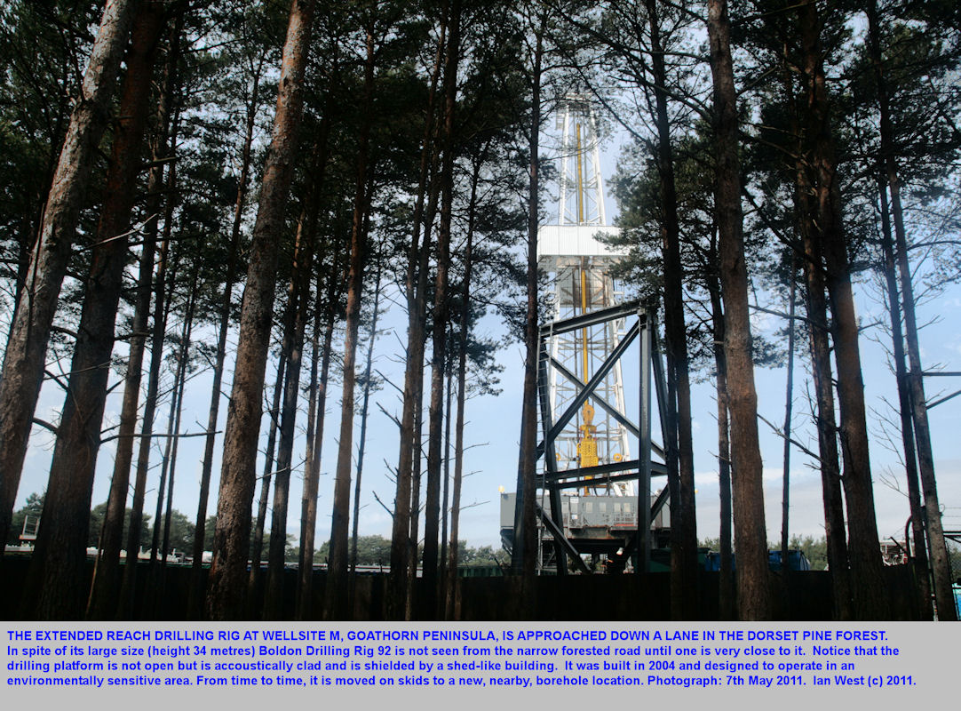 Approaching Wellsite M with the Boldon ERD drilling rig seen through the trees, Wytch Farm Oilfield, Dorset, Southern England, 2011