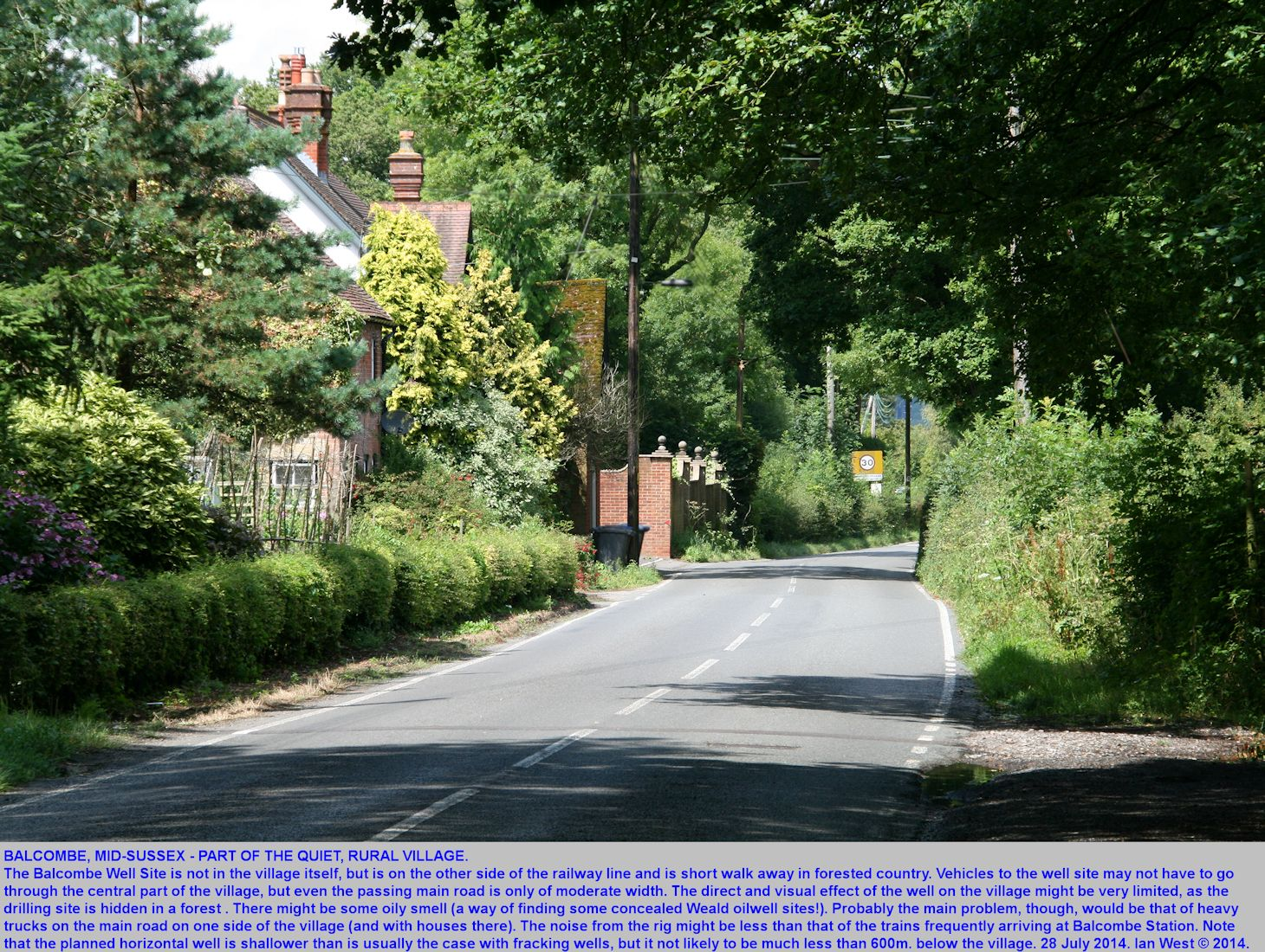 Balcombe, Sussex, the well-known well-site locality, part of the village environment shown here, a quiet village road
