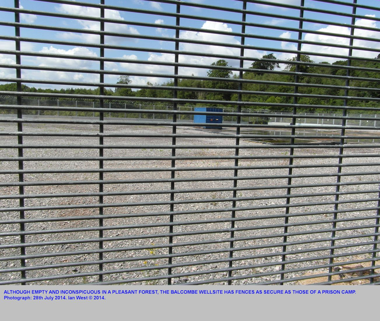 High security, steel fencing at the Balcombe oilwell site, July 2014