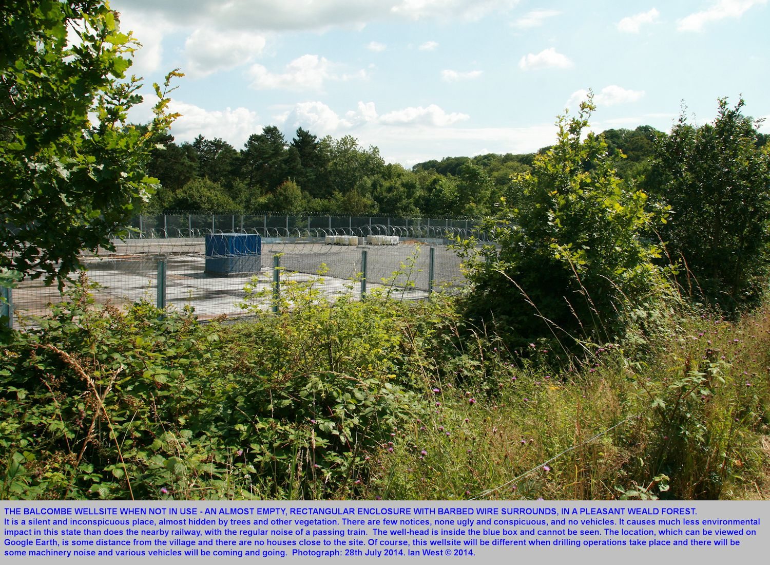 The Balcombe wellsite when not in use is inconspicuous and it is hidden in a quiet forest of the Weald, near a railway, but away from houses, photograph July 2014