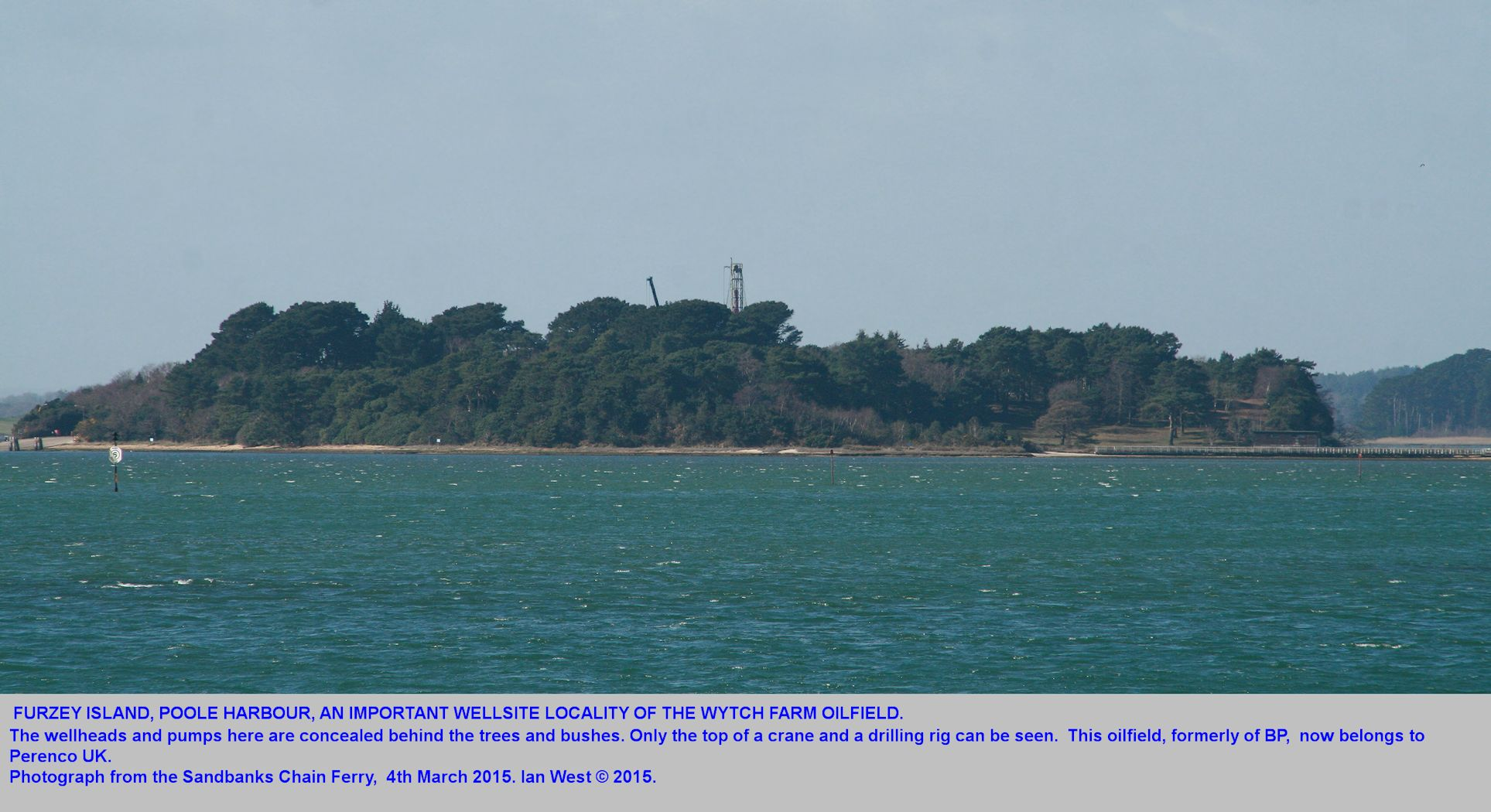 Furzey Island, a major wellsite locality of the Wytch Farm Oilfield, seen from the Sandbanks Chain Ferry, 4th March 2014