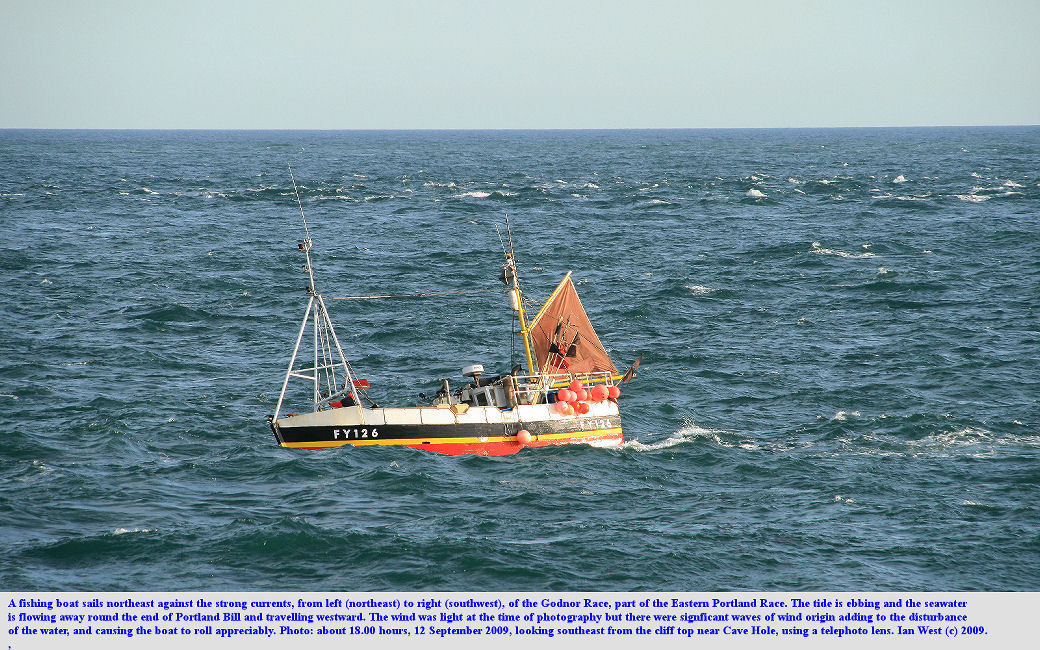 A fishing boat sails northeast against the Godnor Race, part of the Eastern Portland Race or strong current, from the cliffs near Cave Hole, Isle of Portland, Dorset, 11th September 2009