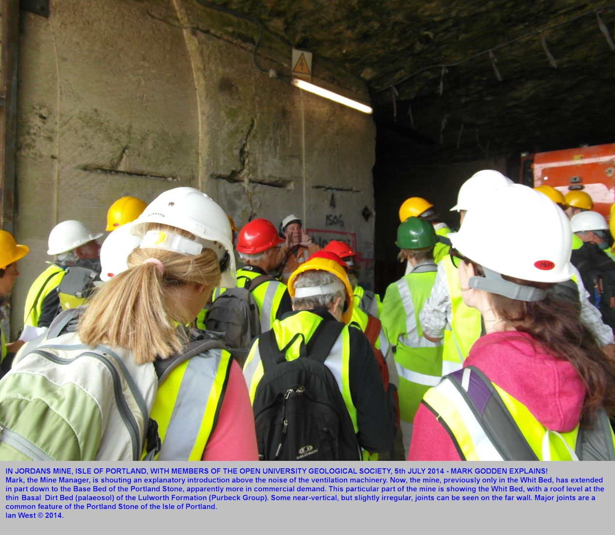 In Jordans Mine, not far from the entrance, the Mine Manager, Mark Godden, shouts an explanation to members of the Open University Geological Society, Isle of Portland, Dorset, 5th July 2014