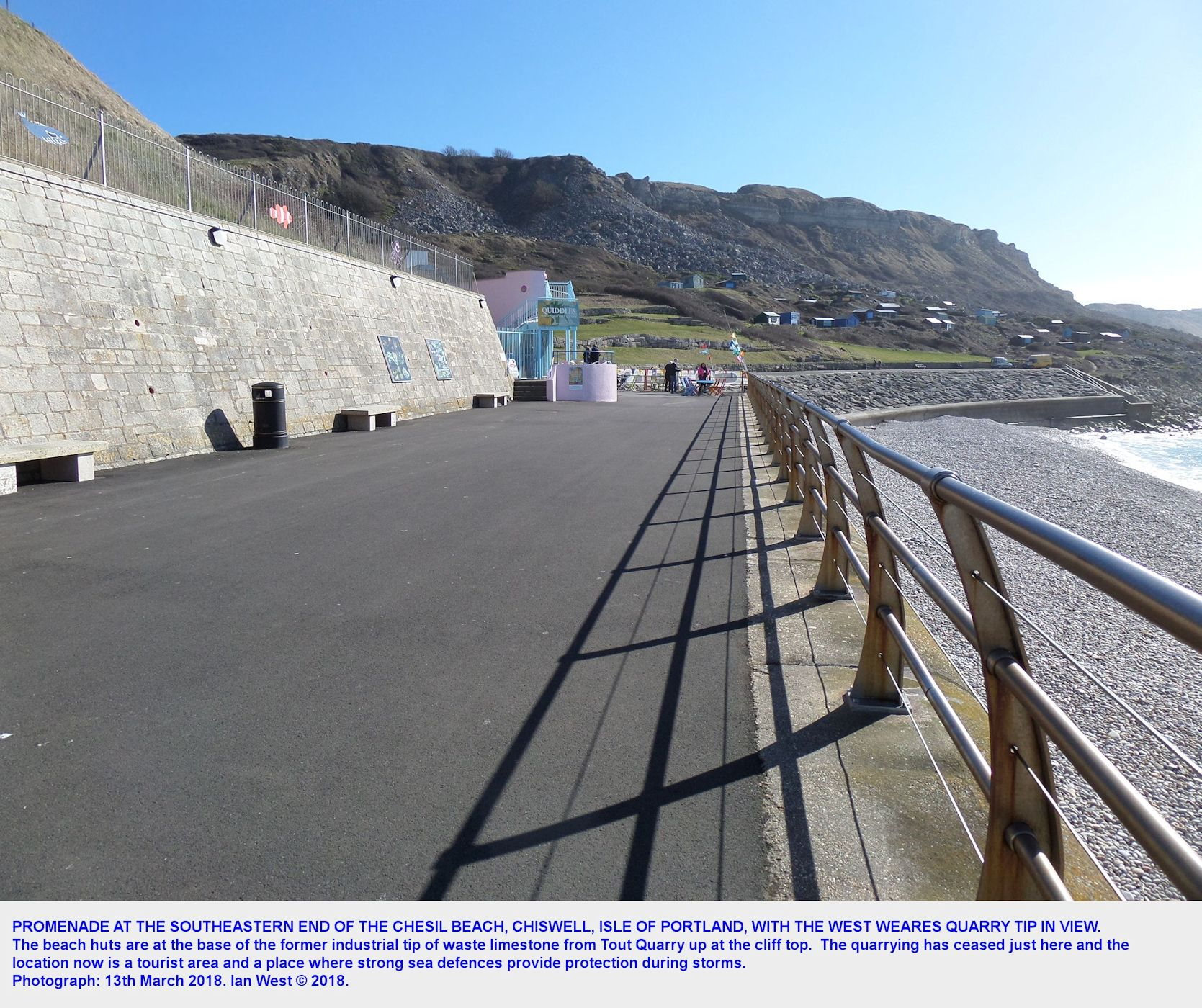 Seen from the promenade at the southeastern end of the Chesil Beach, Dorset, the waste tip of quarry debris, at West Weares, Isle of Portland