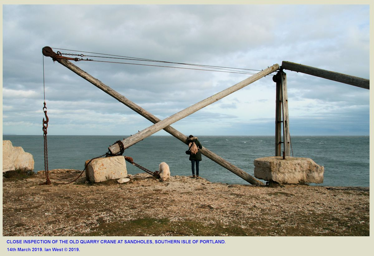 Close inspection of the old crane at Sandholes, Isle of Portland, Dorset, during a field trip with Anna Best and her dog, 14th March 2019