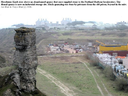 Nicodemus Knob, Portland, Dorset, seen on its setting in an abandonned quarry, with the old prison visible in the distance