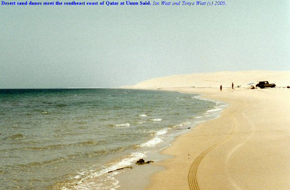 Desert dunes reach the sea at Umm Said, southeast Qatar