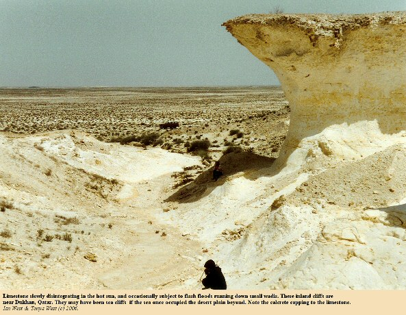 Dry cliffs of limestone near Dukhan, Qatar, with degradation in the hot sun and occasional erosion by flash floods