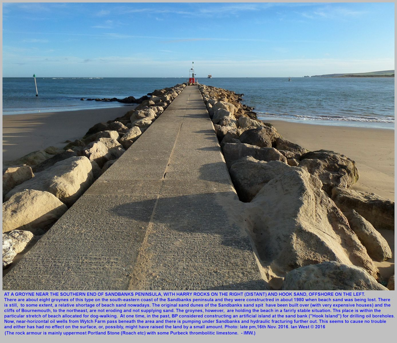 A groyne of concrete with rock armour at the southeastern part of the Sandbanks Peninsula, Dorset, within the dog-walking beach area